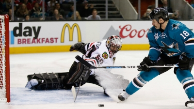 Blackhawks Steamroll Sharks in 5-2 Slugfest