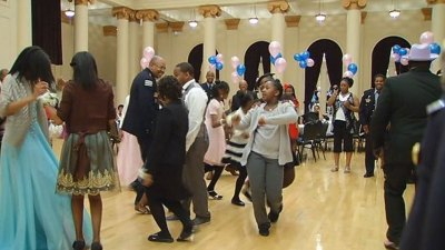 Cops Escort Girls Without Dads to Dance