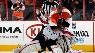 Watch: Former Hawks Goalie Brawls on Ice