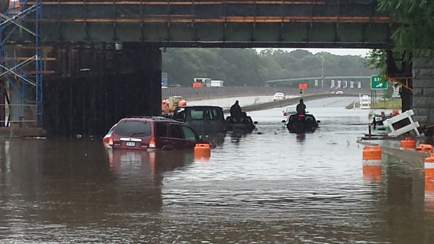 PHOTOS: Record-Setting Rains Cause Flash Flooding, Strand Drivers