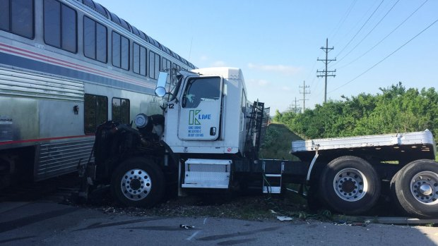 PHOTOS: Truck Full of 70,000 Pounds of Bacon Crashes Into Train