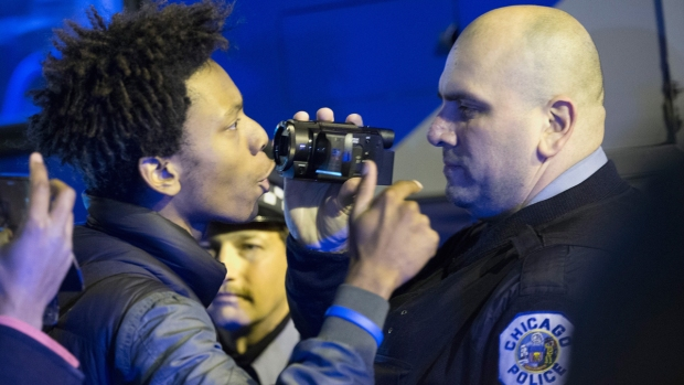 Images Capture Tense Moment Between Protesters, Police
