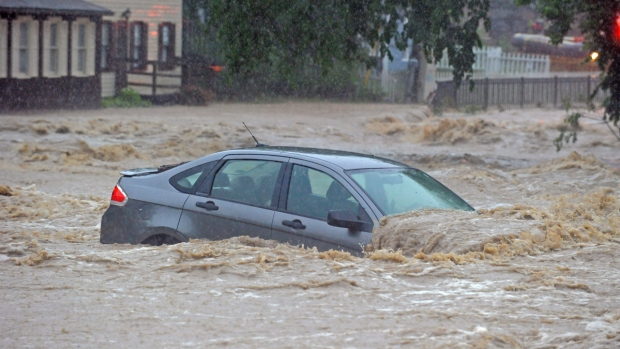 [NATL-DC] Dramatic Images: Floods Crush Cars, Destroy Streets in Ellicott City
