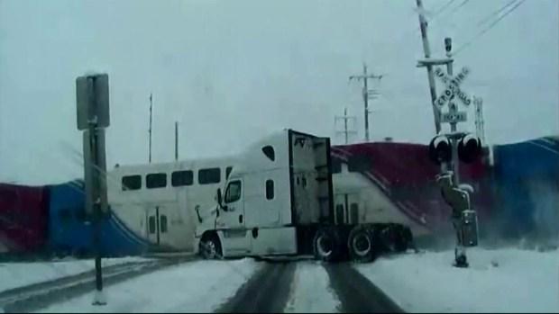 [NATL-DFW] Train Slams Into FedEx Truck on Tracks