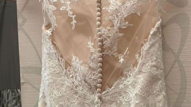 Woman Donating Unused Wedding Dress to Deserving Bride