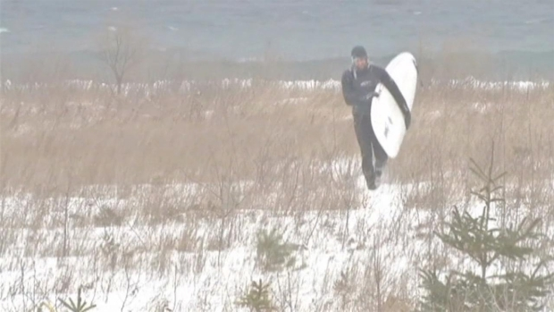 Surfers Brave Winter Waves on Lake Michigan