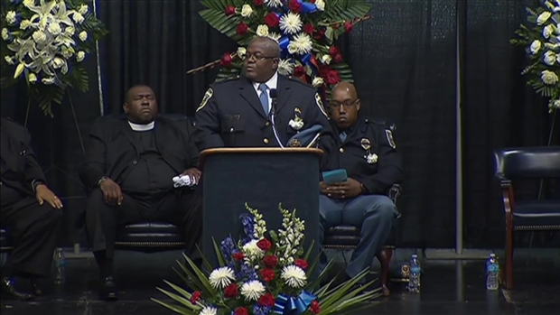 [CHI] Crowds Honor Slain Gary Officer at His Funeral