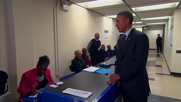 Obama Takes Part in Early Voting