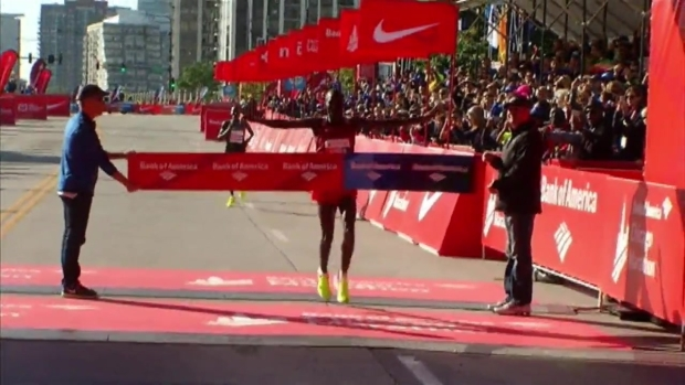 Abel Kirui Does Victory Dance at Chicago Marathon Finish Line
