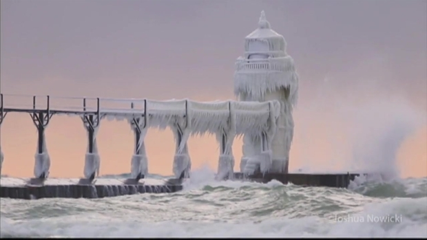 Stunning Video Shows Lighthouse Along Lake Michigan Completely Frozen