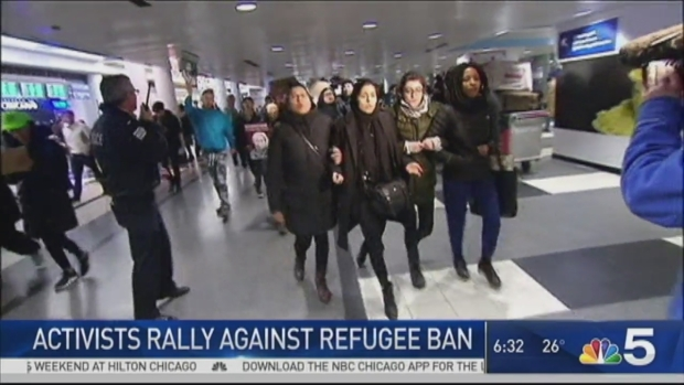 [CHI] Detainees at O'Hare Released to Protesters' Cheers