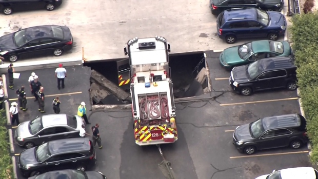 [NATL] Fire Truck Gets Stuck After Partial Parking Garage Collapse