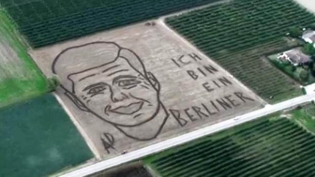 [NATL] Artist Plows JFK Portrait in Field