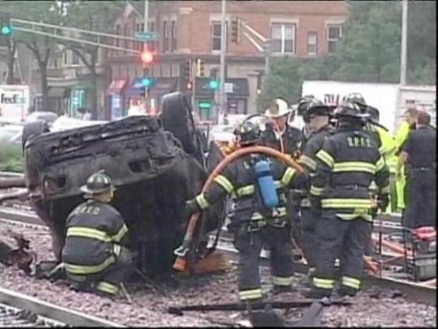 [CHI] Car Bursts Into Flames After Train Collision