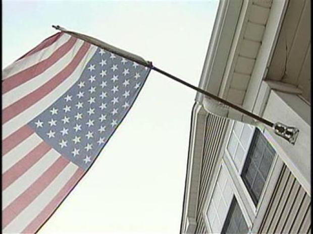[CHI] Flipping Mad: Woman Flies Flag Upside Down