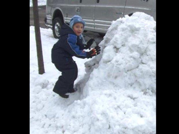 Father, Son Construct Massive Snowman