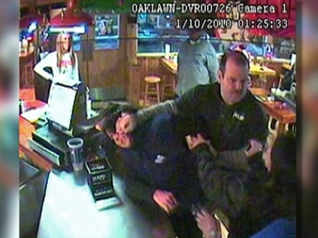 [CHI] Surveillance Video:  Security Guard, Grandmother Tussle at Hooters