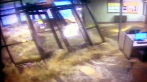 [AP] RAW VIDEO: Flood Waters Crash Through Campus
