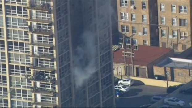 [CHI] Raw: Chicago Firefighters Battle High-Rise Blaze