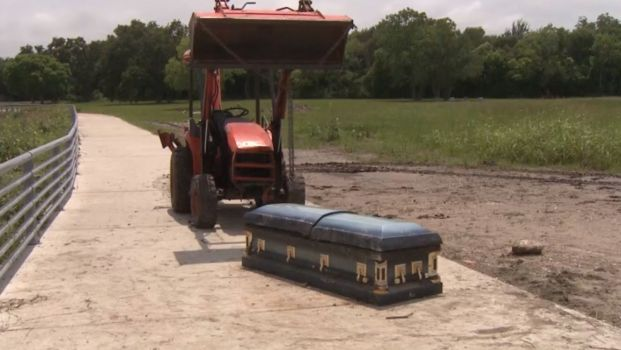 Startled Cyclist Discovers Unearthed Casket After Massive Texas Floods