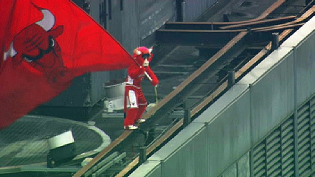 Benny the Bull Waves Flag Atop Willis Tower