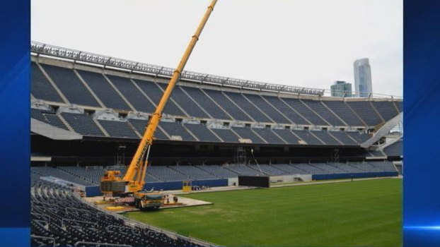Crews Install New Scoreboards at Soldier Field