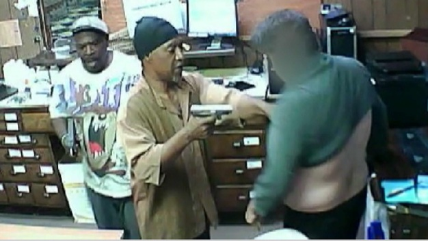 Gun-Toting Robbers Caught on Video at Medical Clinic