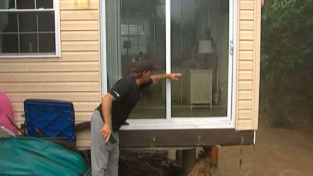 PA Flood Leaves House Teetering, Family Stuck on Roof