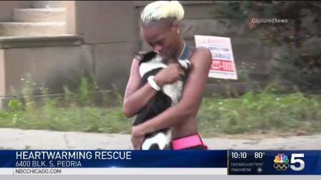 Chicago Firefighter Emerges From Smoke With Family's Cat