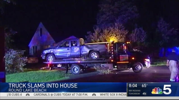 Truck Crashes Into Suburban Home