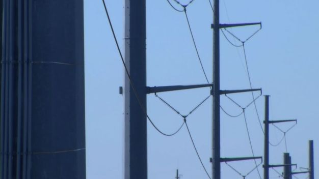Wind Downs Power Lines in Michigan, Indiana and Illinois