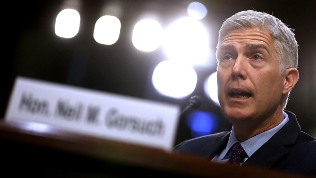 Divided Senate confirms conservative jurist Neil Gorsuch to the Supreme Court