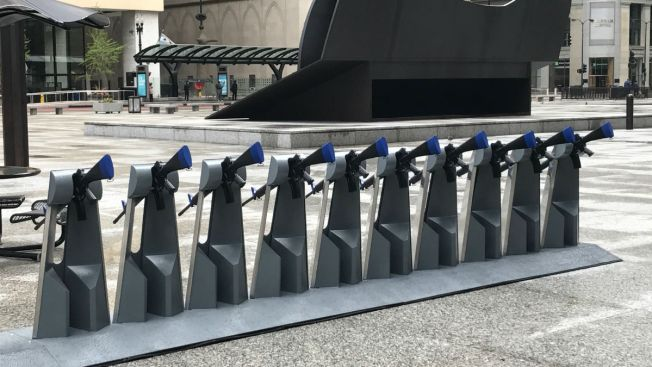 Provocative 'Gun Share' Artwork Sparks Discussion in Daley Plaza