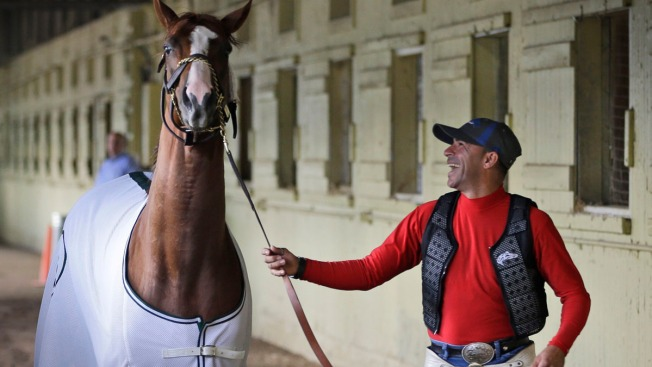 California Chrome Gallops in Slop at Belmont
