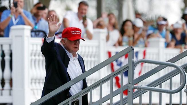 'Trump, I Love You,' and 'Putin Won' Greet President at Open