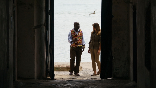 In First Solo International Trip, Melania Trump Walks Through Ghana's 'Door of No Return'