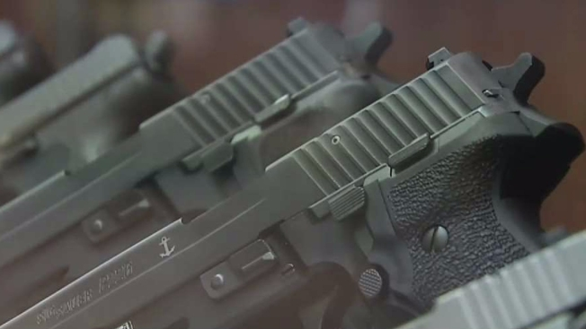 2 Charged With Conspiring to Buy Wisconsin Handguns, Resell Them in Chicago