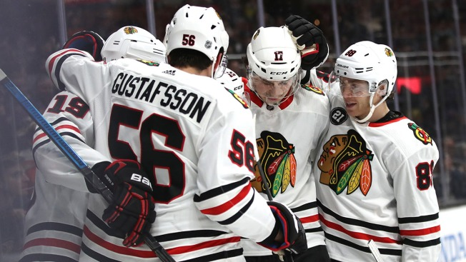 Alex DeBrincat Scores Twice as Blackhawks Beat Sharks