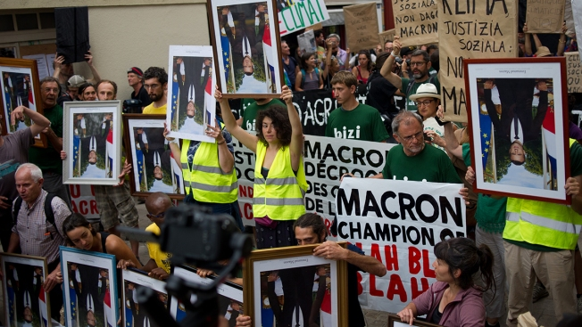 Climate Change Activists Nab French President Macron's Portraits, Divide French Judges