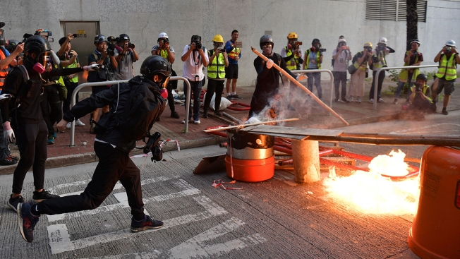 Hong Kong Protesters, Police Face Off in Renewed Clashes