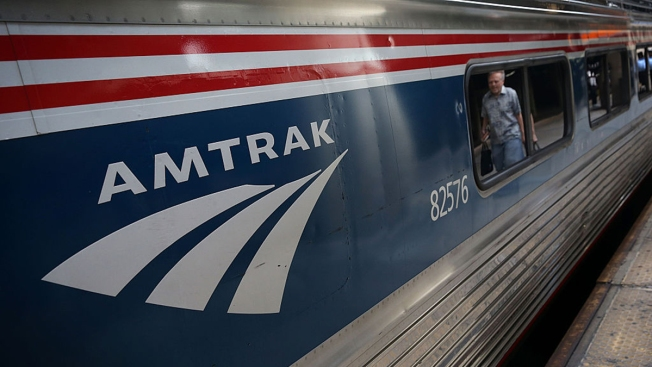 Deliveryman takes pizza to riders on stalled Amtrak train