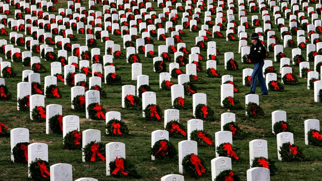Volunteers Lay Thousands of Wreaths at Arlington National Cemetery Despite Drenching Rain