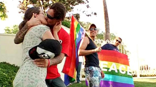 Kiss Off: Activists Pucker Up for Protest