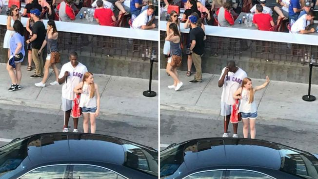 Woman praised for helping blind Cubs fan hail cab after game