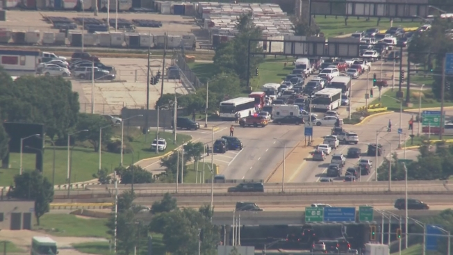 Multiple People Injured After Shuttle Bus Hits CPD Car During Traffic Stop Near O'Hare Airport: Police