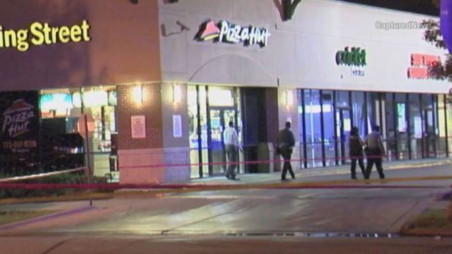 Four Shot Outside South Side Strip Mall