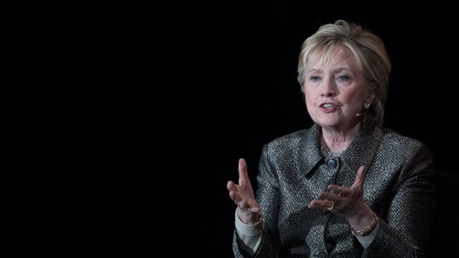Hillary Clinton chides Donald Trump on Syrian refugee ban after airstrikes