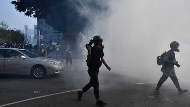 Hong Kong Protesters Criticize Police Conduct, Draw Tear Gas