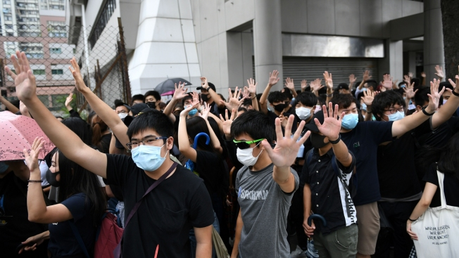 2 Protesters Charged in 1st Use of Hong Kong's New Mask Ban