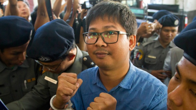 Reuters journalists charged with violating colonial-era Myanmar law